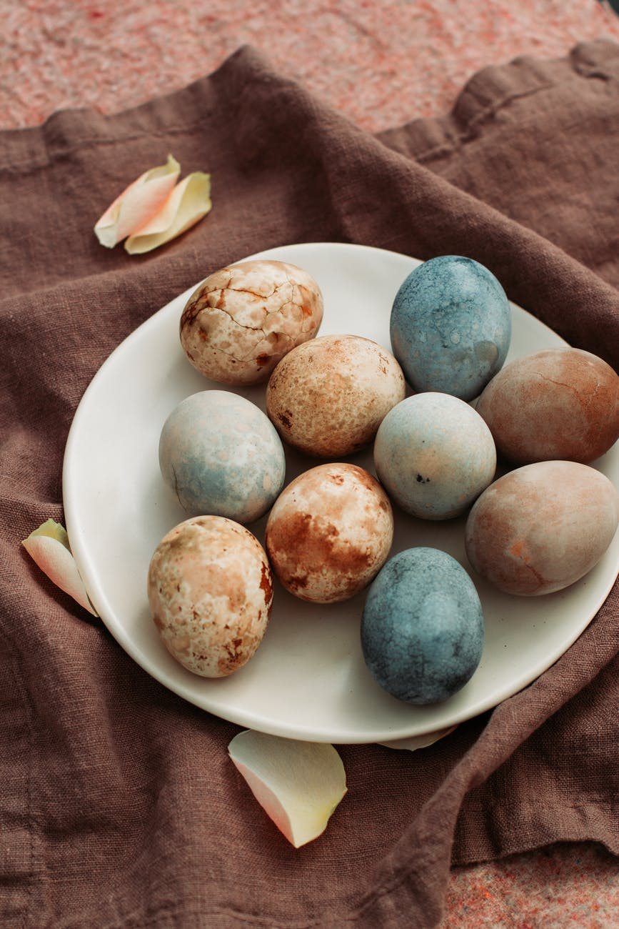 plate with different eggs for easter holiday