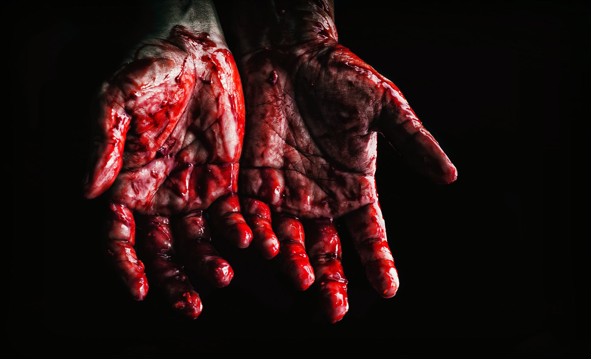 person s hands covered with blood
